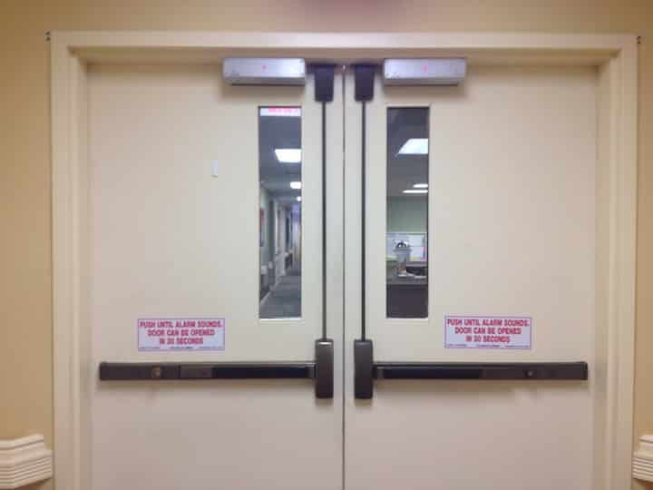 image of a commercial double door with panic bars and door closers.