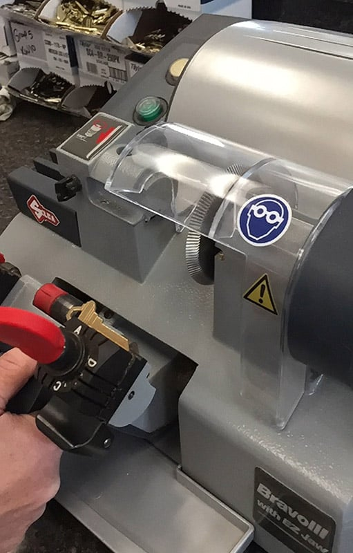 Photo of a professional key cutting machine in use.